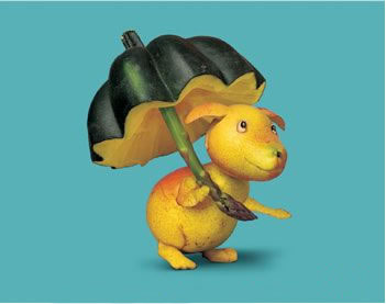 dog going for a walk with umbrella, made of mangoes