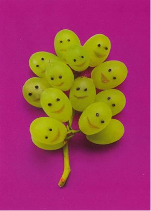 happy people made of grapes